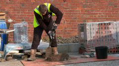 Builder with a shovel Stock Footage