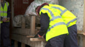 Builders sawing wood Footage