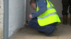 Workman busy painting wall grey Stock Footage