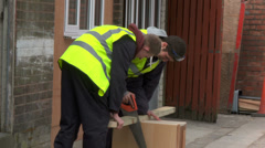 Construction workers sawing wood Stock Footage