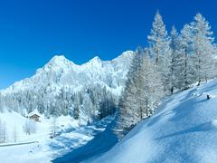 morning winter alpine road. - stock photo