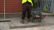 Stock Video Footage of Workman cleaning up mess