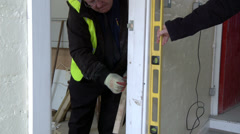 Man checking spirit level on wall Stock Footage