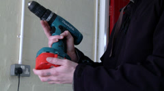 Battery pack being placed on drill Stock Footage