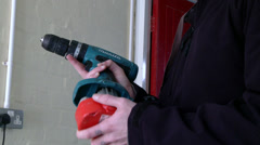 Worker replaces battery on drill Stock Footage