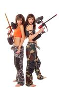 Girls playing paintball Stock Photos