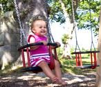 Stock Photo of baby on swing