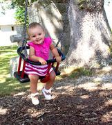 Baby on swing Stock Photos