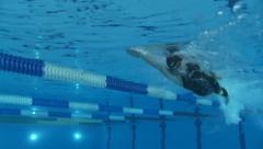 Man swimming, crawl style - underwater shot Stock Footage