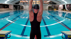 Man swimmer limber up in swimming pool Stock Footage