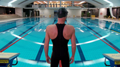Man swimmer before starting in a swimming pool Stock Footage