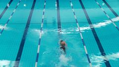 Man swimmer, crawl swimming in pool Stock Footage