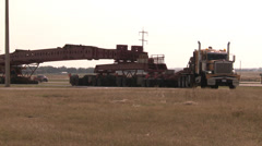 Transportation, oversize load 192 wheel transport enters pullout Stock Footage