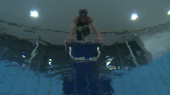 Man swimmer ready to jump on starting block - view from underwater Stock Footage