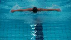 Man butterfly swimming - front view Stock Footage