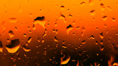 drop of water runs down the glass surface with condensate - stock footage