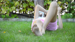 Hd little girl laying in field grass - stock video Stock Footage