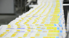 Web offset printing press folding a daily newspaper - stock video Stock Footage