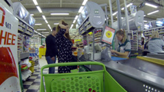 The buyer is paying at the checkout a large food shopping center - stock footage