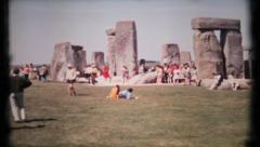 464 - Stonehenge is visited by tourist on summer day - vintage film home movie Stock Footage