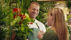 9of20 people in flower shop with florist and customer - stock footage