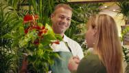 Stock Video Footage of 9of20 people in flower shop with florist and customer