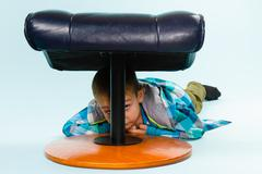 Little boy and footstool Stock Photos