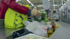 Collection of food and goods into bags in a large shopping center Stock Footage