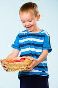 Stock Photo of boy and fruit basket