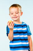 Stock Photo of boy and apple