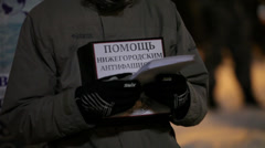 """Protester with poster """"Help for anti-fascist of Nizhniy Novgorod"""" Stock Footage"""