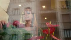 14of20 people in flower shop with florist and customer Stock Footage