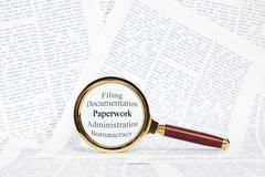 Paperwork and magnifying glass concept Stock Illustration