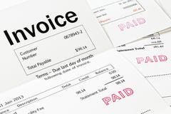 Invoices with paid stamp Stock Photos