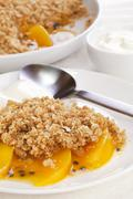 Crumble with peach and passion fruit Stock Photos