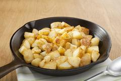 Home fries or saute potatoes in a skillet Stock Photos