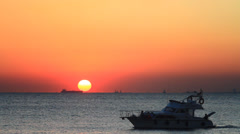 Pleasure boat cruising at sunset Stock Footage