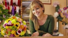 17of20 people in flower shop with florist and customer - stock footage