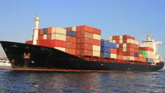 Container ship arriving in port - stock footage