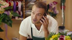 19of20 people in flower shop with florist and customer - stock footage