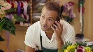 Stock Video Footage of 19of20 people in flower shop with florist and customer