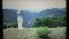 467 - tourist stops at scenic overlook to take photo - vintage film home movie Stock Footage