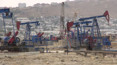 Oil donkeys in Baku, petroleum industry, pumpjacks desert, Azerbaijan Stock Footage