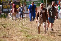 Elderly male zombie waits to terrorize runners in 5k race Stock Photos