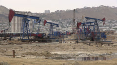 Oil donkeys, petroleum industry, onshore drilling, gasoline, Azerbaijan Stock Footage