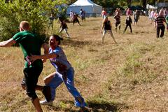 Female zombie nurse chases runner in scary 5k obstacle race Stock Photos