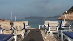 Sun loungers and sea panorama Stock Footage