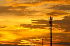 Twilight sky with communication antenna tower Stock Photos