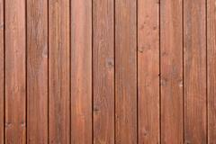 part of fencing with brown varnish - stock photo