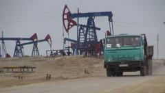 Old Soviet truck drives through Azeri oil field, industry, transportation Stock Footage